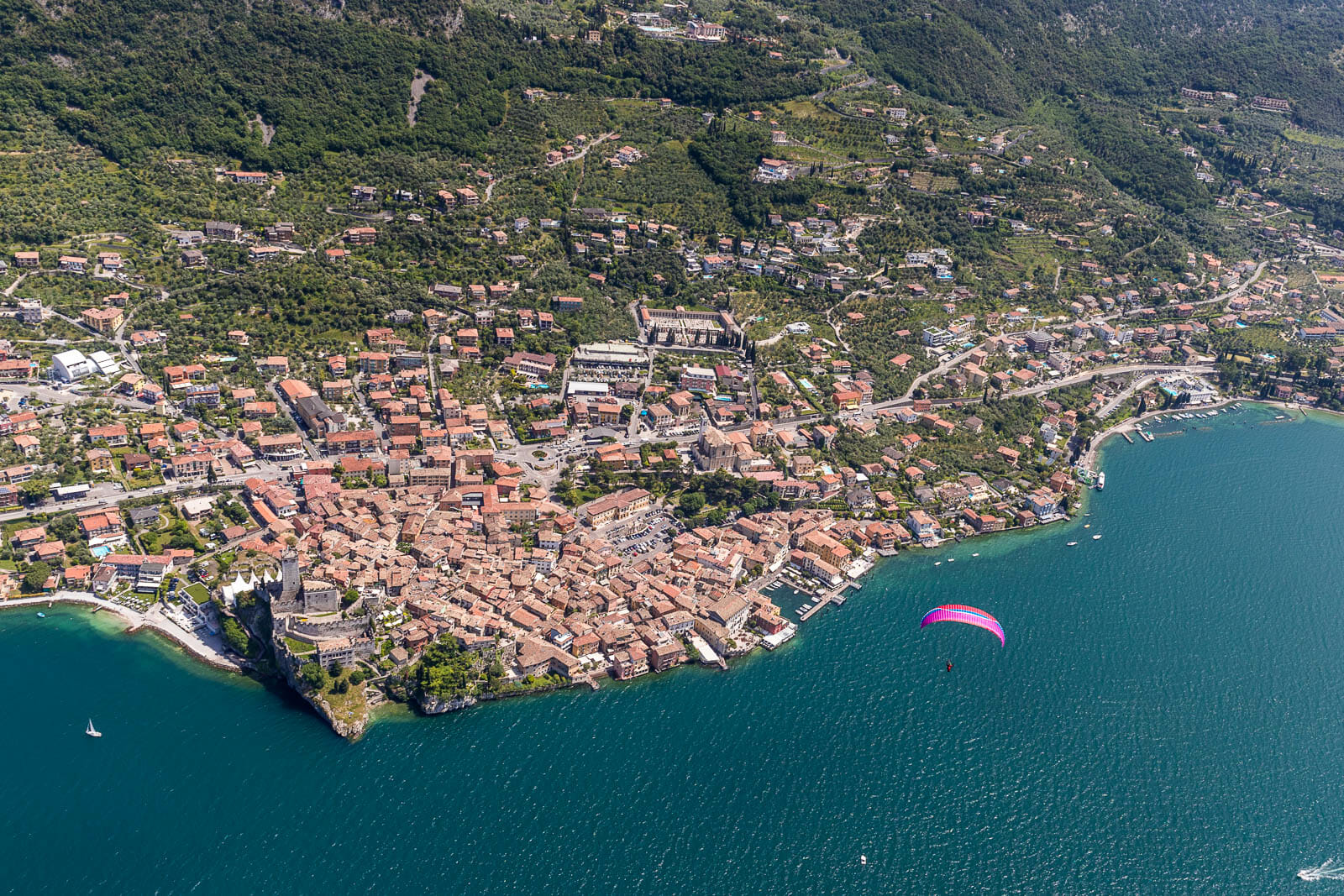 paraglide flying over malcesine