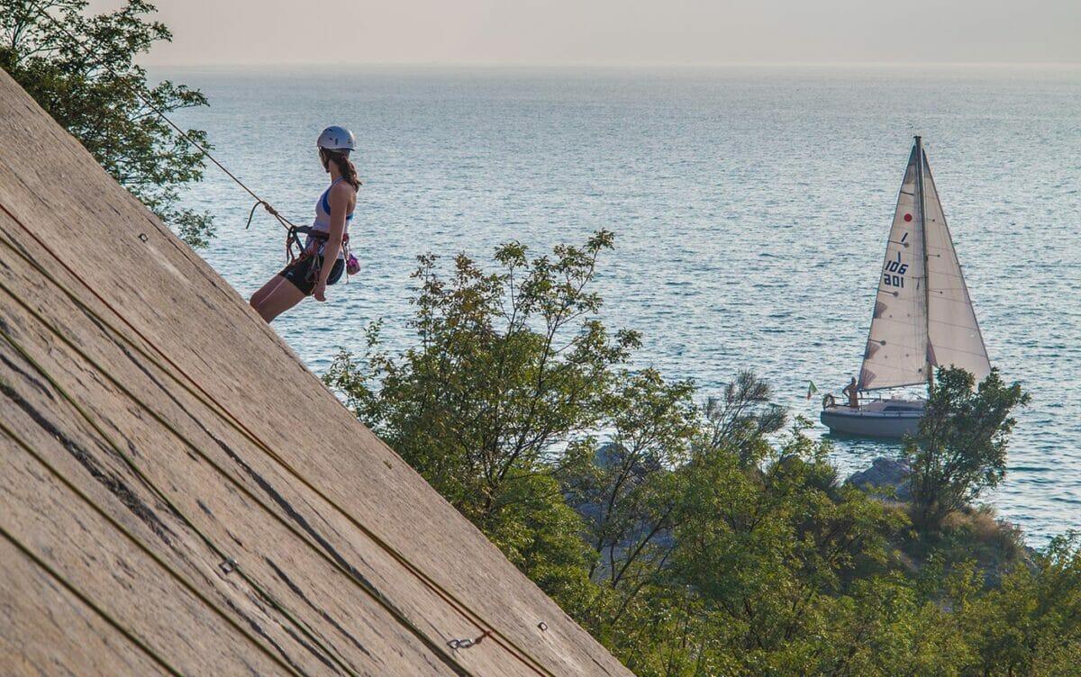 climbing at corno di bo with lake view