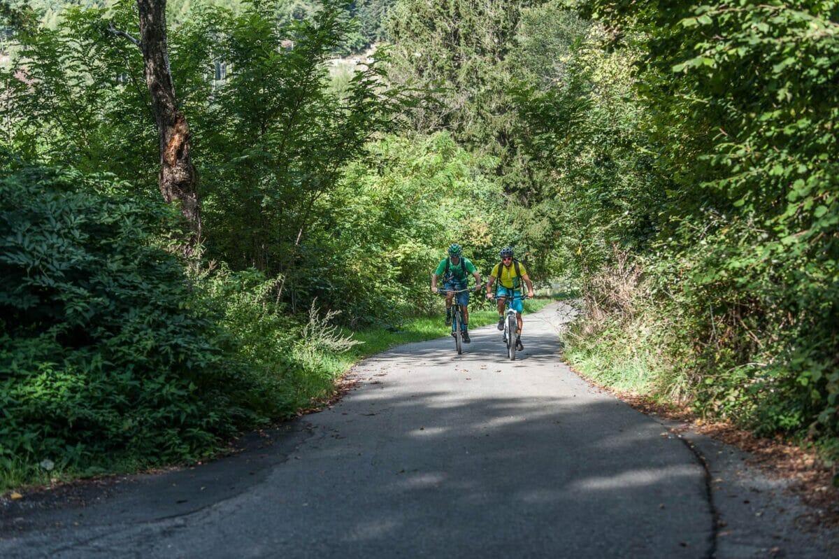 biking uphill on tarmac road in prada