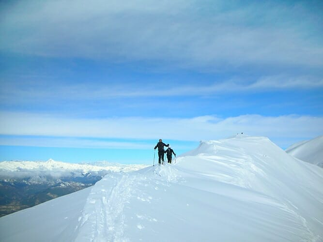 ski tourer over cima costabella