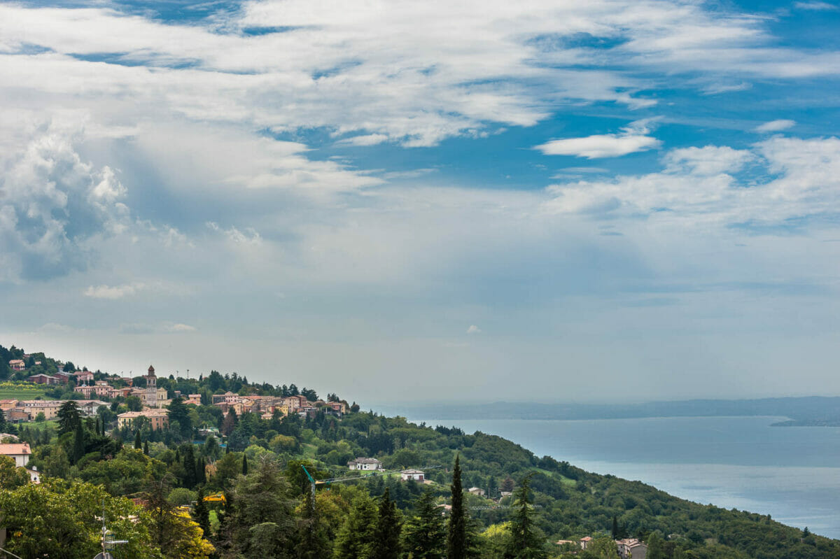 view of san zeno di montagna with garda lake