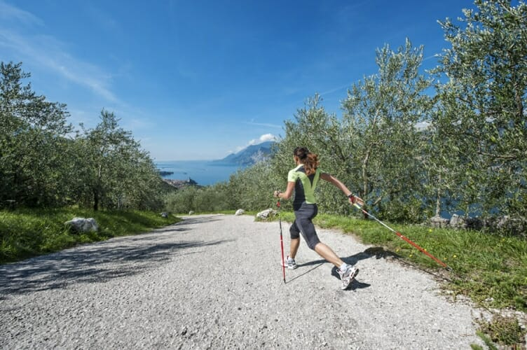 girl doing nordic walking on trail