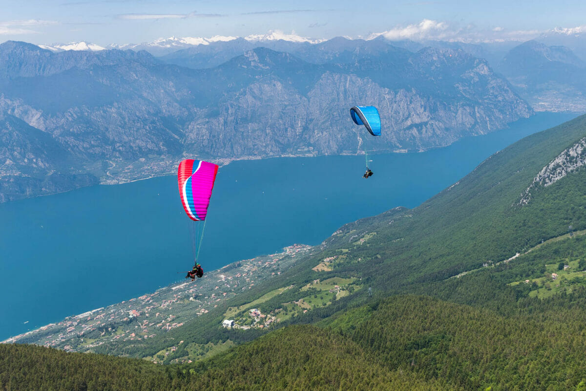 two paragliding during flight