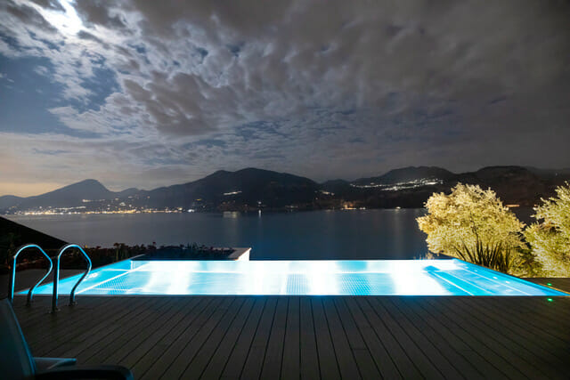 Pool by night with lake view
