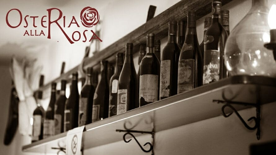 osteria alla rosa logo and wine bottles